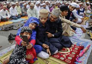 An Indian Muslim family takes a selfie after offering Eid al-Fitr prayers in Mumbai.