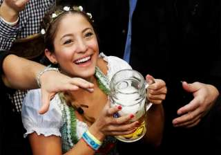 A young woman is all smiles during the opening of the 183rd Oktoberfest beer festival.