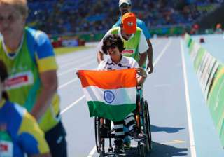 India's Deepa Malik holds the Tricolour after winning the silver medal in the women's shot put F53 athletics event during the Paralympic Games at the Olympic Stadium in Rio de Janeiro, Brazil, Monday, Sept. 12, 2016.