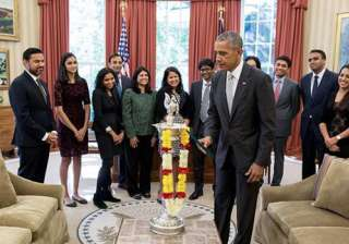 Obama celebrates Diwali, lights first-ever diya in Oval Office.