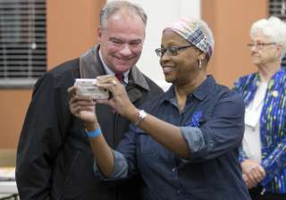 Democratic vice presidential candidate Tim Kaine, takes a selfie with a poll worker as he prepares to vote in Richmond