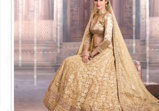 'Lehenga: Lehenga and choli speaks volumes of grace and ethnicity. Be a head turner this wedding season and sport this gold lehenga with minimal jewellery and dewy make-up. Bend the rules and resort for a gold lehenga rather than the usual red lehenga.