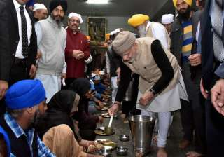 PM Modi also knelt and bowed five times before the Sikh Holy book and was honoured with a siropa.