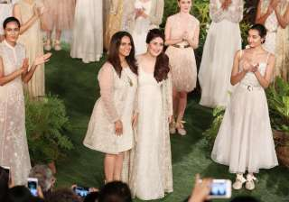 Bebo who is also the face of Lakme Absolute, was very happy and said that she has always loved to work. She was all smiles as she posed with designer Anita Dongre.
