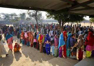 Indians wait in a queue to cast their votes at a polling booth in New Delhi.