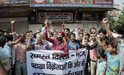 File pic - Traders shout slogans during a protest against