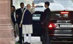 Prime Minister Narendra Modi flashes victory sign after