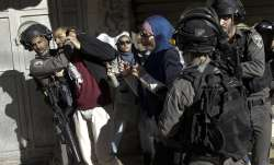 Israeli police arrest a Palestinian during a protest
