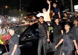 PM Modi waves at people during a road show in Surat on- India Tv