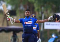 Danushka Gunathilaka celebrates after scoring a century