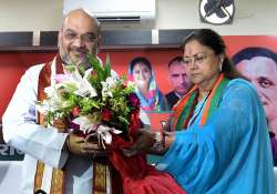 Amit Shah being felicitated by CM Raje during a party- India Tv