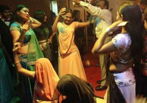 Showering money on girls in dance bars against dignity and- India Tv