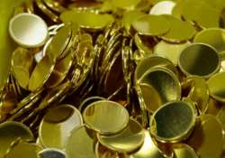gold remains up on hectic buying global cues