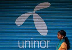 unitech to sell its uninor stake to telenor