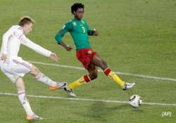 danes send cameroon packing dutch into last 16