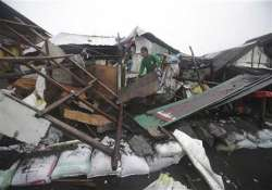storm exits sparing philippines of huge losses
