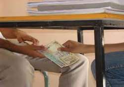 cop and village official caught red handed accepting bribes