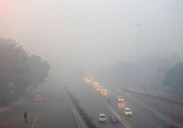 Traffic moves on a road enveloped by smoke and smog, on the morning following Diwali festival in New Delhi, India, Monday, Oct. 31, 2016. As Indians wake Monday to smoke-filled skies from a weekend of festival fireworks for the Hindu holiday of Diwali, New Delhi's worst season for air pollution begins, with dire consequences. A new report from UNICEF says about a third of the 2 billion children in the world who are breathing toxic air live in northern India and neighboring countries, risking serious health effects including damage to their lungs, brains and other organs.
