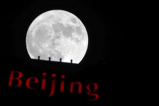 The Supermoon rose above an office building in Beijing, China.