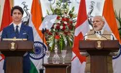Prime Minister Narendra Modi speaks as his Canadian
