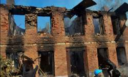 Kulgam: People clearing debris from the damaged house where