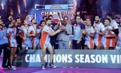 Players and officials of Bengal Warriors celebrate with the