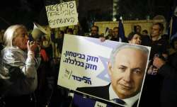 Supporters of Israeli Prime Minister Benjamin Netanyahu gather outside his residence in Jerusalem. I