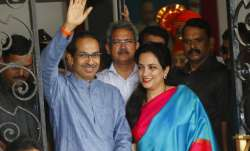 Shiv Sena chief Uddhav Thackeray waves to the crowd, with