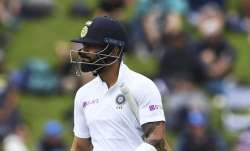 India's Virat Kohli walks from the field after he was