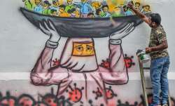 An artist in Guwahati paints a mural depicting a doctor