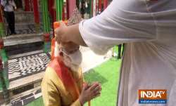PM Modi wears Silver Mukut from Hanumangarhi Mandir priest before heading for Ram Lalla   Photos
