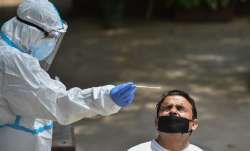 A health worker collects samples for COVID-19 rapid antigen testing, in New Delhi, Tuesday, Aug. 4,