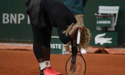 Serena Williams of the U.S. reacts after missing a shot