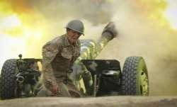 An Armenian serviceman fires a cannon towards Azerbaijan positions in the self-proclaimed Republic o