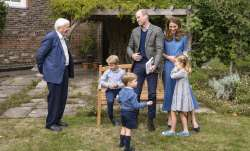 Britain's Prince William, centre, and Kate, the Duchess of Cambridge, react with Naturalist David At