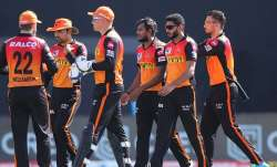 SRH players celebrate a fall of wicket.
