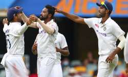 India's Mohammed Siraj, centre, celebrates with teammate
