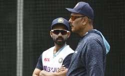 Ajinkya Rahane of India (L) speaks with India head coach
