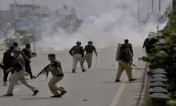 Police fire tear gas to disperse angry supporters of