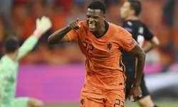 Denzel Dumfries of the Netherlands celebrates after scoring