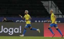 Brazil's Neymar, left, celebrates after scoring his side's