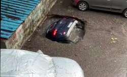 Car sinks into water as concrete floor caves in at Mumbai's Ghatkopar