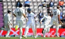 Virat Kohli of India walks off as Kyle Jamieson of New