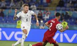 Italy's Ciro Immobile scores his side's second goal during