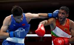 Ashish Kumar (R) of India exchanges punches with Erbieke