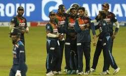 Sri Lankan players celebrate the dismissal of Indias