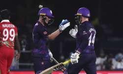 Scotland's batsman Matthew Cross, left, celebrates with teammate Richie Berrington for scoring the w