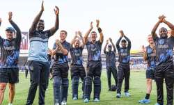 Namibian players gesture to the crowd after qualifying for T20 World Cup Super 12 stage in Sharjah o