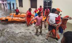 NDRF personnel rescue people stranded in floodwaters in